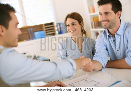 Young couple meeting construction planner