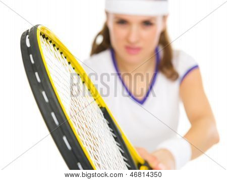 Closeup On Racket In Hand Of Tennis Player In Stance
