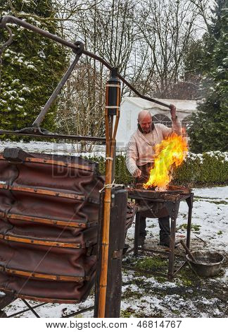 The Blacksmith Working
