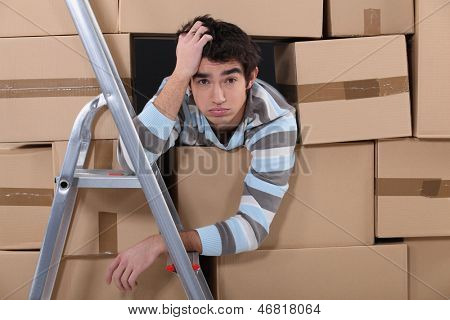 Stressed young factory worker