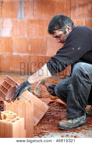 Mason smashing brick