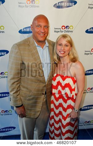 NEW YORK-MAY 29: TV host Steve Wilkos and wife Rachelle attend the Samsung Hope for Children gala at Cipriani Wall Street on June 11, 2013 in New York City.
