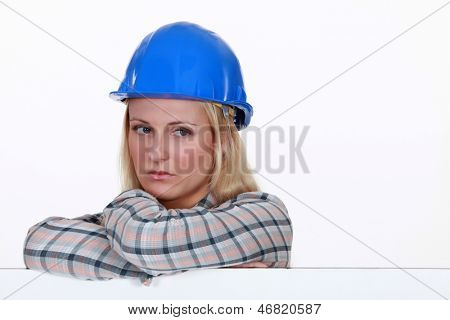 Serious woman in a hard hat