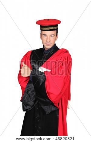 Man in red and black robes and hat