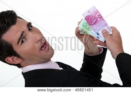 Happy businessman holding banknotes