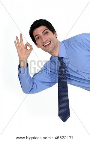 Enthusiastic man giving the a-ok sign