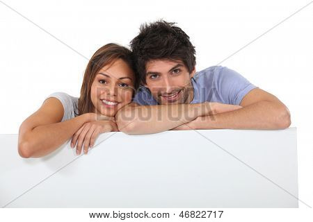 portrait of a couple behind wall