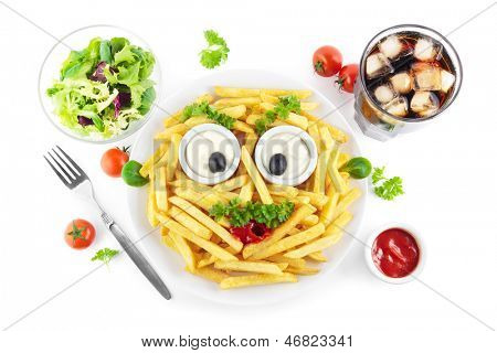 French fries meal with a funny face, salad and soda