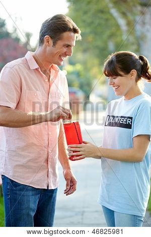 Charity Worker Collecting From Man In Street