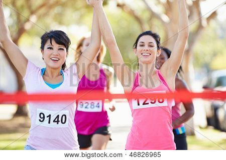 Two Female Runners Finishing Race Together