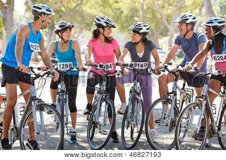 Portrait Of Cycling Club On Suburban Street
