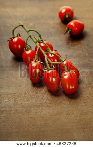 fresh tomatoes  on the wooden background
