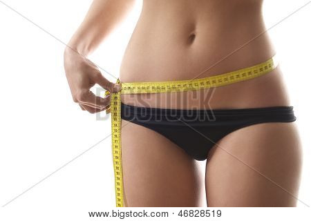 Woman Measuring Waist With Tape On White Background