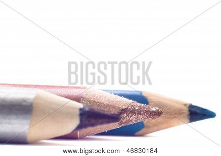 Three cosmetic pencils isolated on white