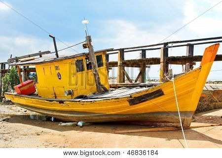 Yellow fishing boat, damaged