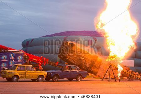 MOSCOW - AUG 25: The car jumped on the trampoline and overturned on Festival of art and film stunt Prometheus in Tushino on August 25, 2012 in Moscow, Russia. The festival was organized in 1998.