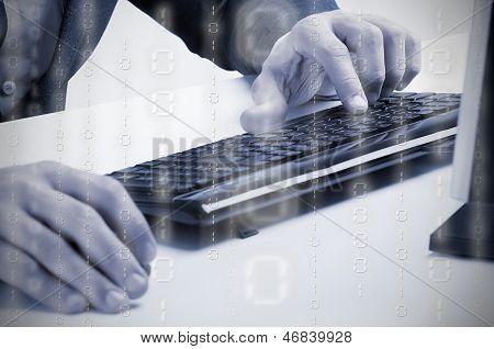 Man Working At A Computer Keyboard