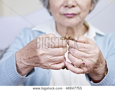 Hands And Prayer Beads
