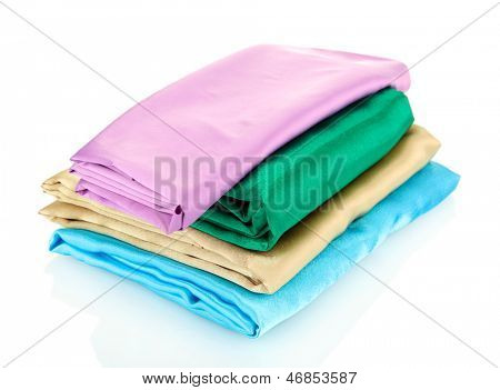 heap of cloth fabrics isolated on white