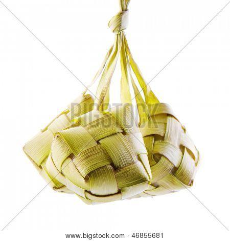 Ketupat or packed rice dumpling. Traditional Malay ramadan food. Popular Malaysian food isolated on white background.