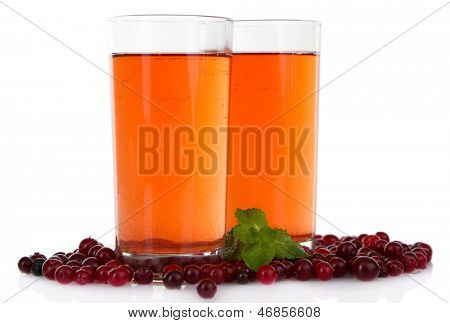 Glasses of cranberry juice and ripe red cranberries, isolated on white