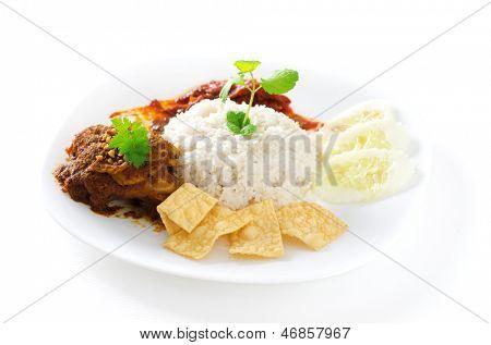 Nasi lemak traditional malaysian spicy rice dish. Served with belacan, ikan bilis, acar, peanuts and cucumber. Malaysian food. Asian cuisine.