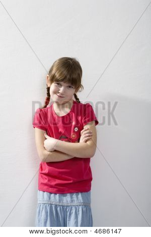 Portrait Young Smiling Girl Standing At Wall