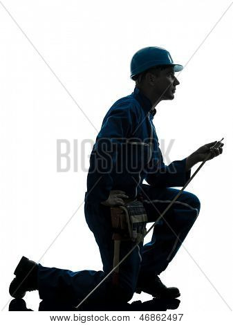 one caucasian man construction worker silhouette in studio on white background