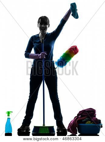 one caucasian woman maid cleaning products brooming   in silhouette studio isolated on white background