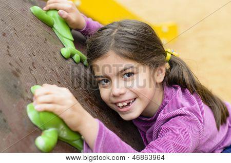 Little Girl On A Climbing Wall