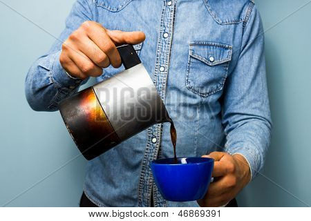 Worker Pouring Coffee From Moka Pot