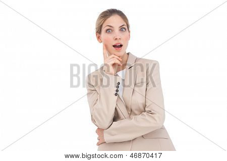 Astonished businesswoman looking at the camera on a white background
