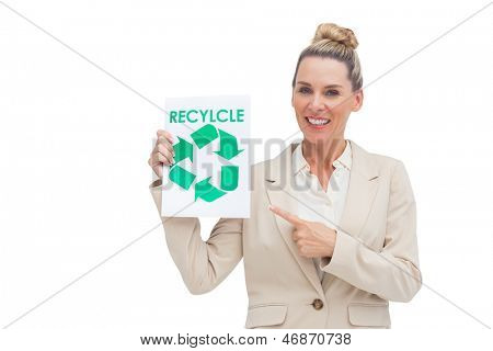 Smiling businesswoman promoting recycling and environment with paper