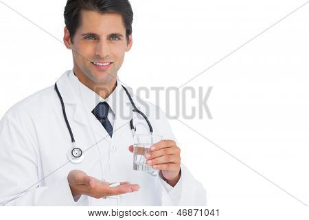 Happy doctor holding tablets and water on white background