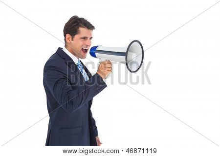 Well dressed businessman shouting with a megaphone