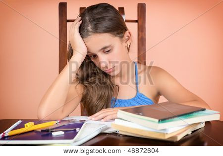 Tired hispanic student  exhausted after studying too much or failing to understand the lesson