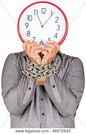 Formally dressed man holding a clock in place of his face with his hands chained with a metallic chain and padlock (useful to illustrate overworked  or stressed people) (isolated on white)