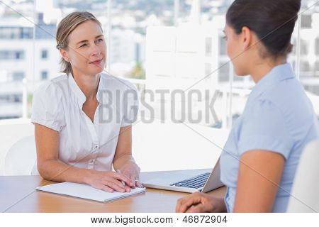 Woman having a job interview with a smiling businesswoman
