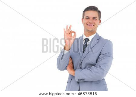 Smiling businessman saying ok with his hand