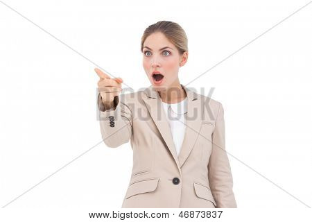 Astonished businesswoman pointing something in front of her