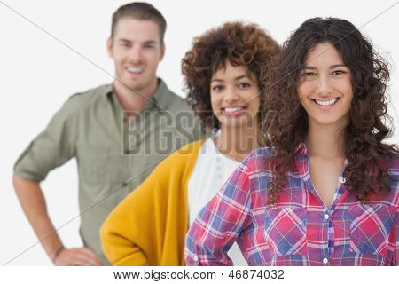 Three stylish friends standing in a row on white background