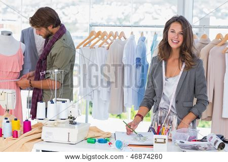 Young fashion designers working in a bright office