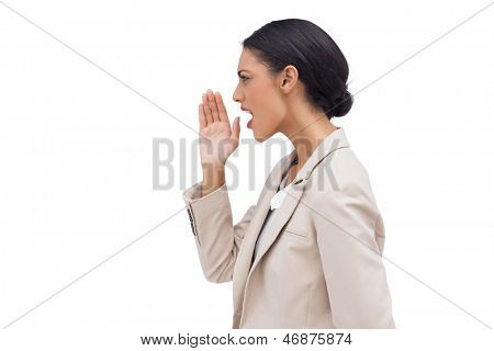 Young businesswoman calling for someone on white background