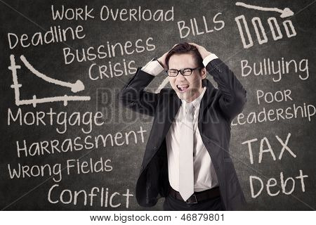 Angry Businessman Shouting In Class