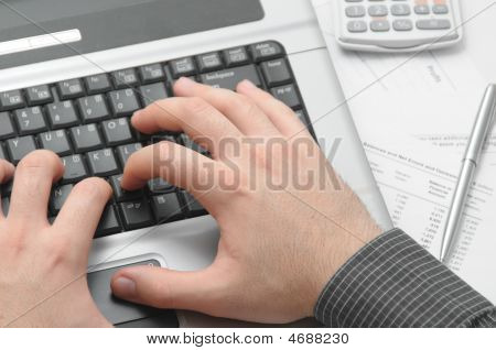 Businessman Typing On Notebook (laptop)