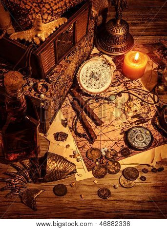Pirates treasure still life on wooden table, luxury medieval things background, stolen money and jewelry, crime lifestyle concept