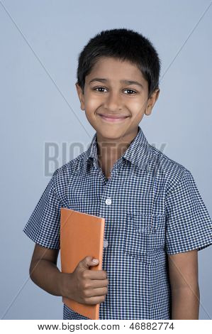 Handsome Indian toddler ready to go to school