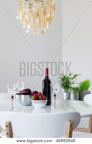 Elegant Table With Red Wine And Fruits