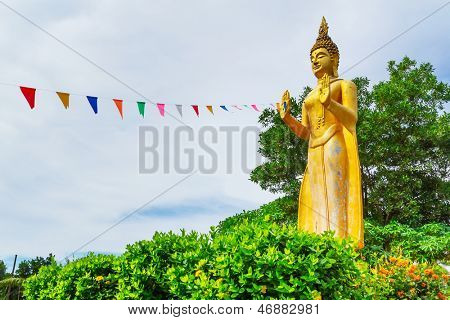 PHANG NGA, THAILAND - NOV 15: Statue of standing golden Buddha Buddha in Ban Nam Khem Tsunami Memorial Park. Pilgrimage site in Phang Nga, Thailand, Nov.15, 2012