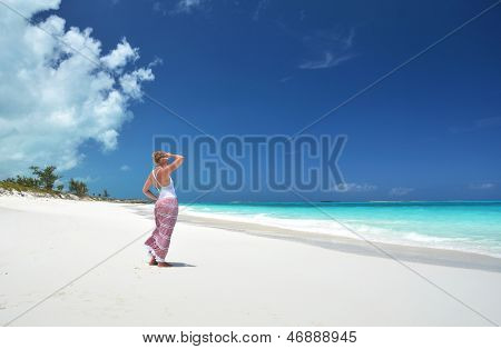 Girl on the desrt beach of Little Exuma, Bahamas